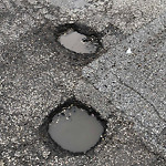 Pothole in Street Complaint at 2431 w. Jackson